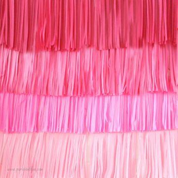 Un maxi mur de pompons frangés